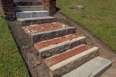 Old exterior steps and landings of rusticated stone, brick, and marble, horizontal aspect Stok Fotoğraf