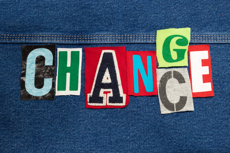 Bright CHANCE - CHANGE word collage from cut out tee shirt letters on denim, innovation, horizontal aspect