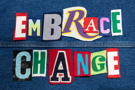 Colorful EMBRACE CHANGE word collage from cut out tee shirt letters on denim, skill development, horizontal aspect Imagens