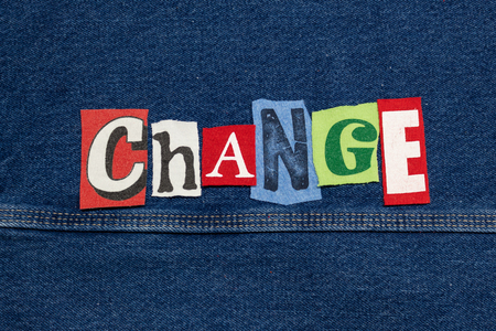 Colorful CHANGE word collage from cut out tee shirt letters on denim, company innovation, horizontal aspect Imagens