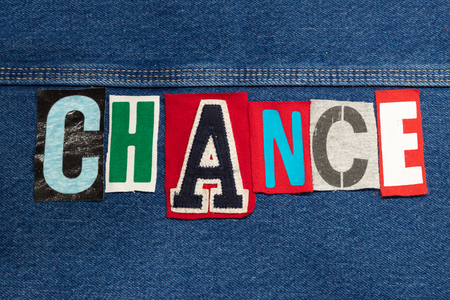 Bright CHANCE word collage from cut out tee shirt letters on denim, personal growth, horizontal aspect