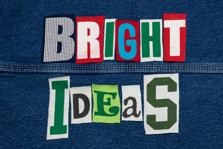 BRIGHT IDEAS word collage from cut out tee shirt letters on denim, teamwork, horizontal aspect Imagens