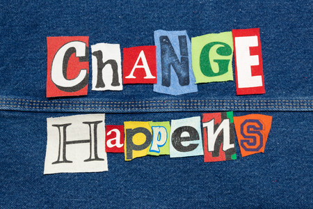 Colorful CHANGE HAPPENS word collage from cut out tee shirt letters on denim, horizontal aspect