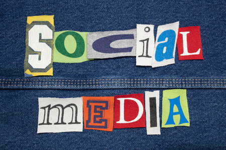 SOCIAL MEDIA word collage on denim with tee shirt lettering cut out, personal marketing, horizontal aspect