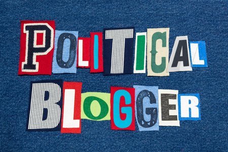 POLITICAL BLOGGER text word collage colorful fabric on blue denim, politics and government blogs and blogging, horizontal aspect Banque d'images