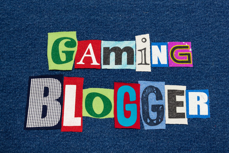 GAMING BLOGGER text word collage colorful fabric on blue denim, gaming tips blogs and blogging, horizontal aspect