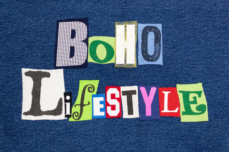 BOHO LIFESTYLE text word collage, colorful fabric on blue denim, natural and Bohemian, horizontal aspect