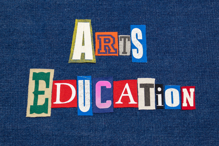 ARTS EDUCATION text word collage, colorful fabric on blue denim, humanities education, horizontal aspect