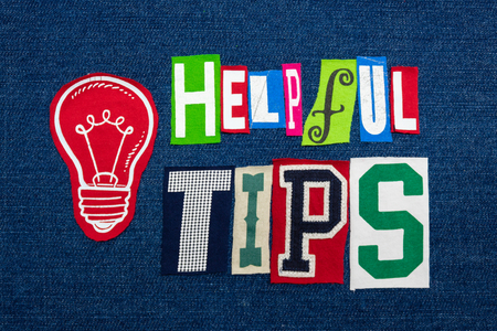 HELPFUL TIPS text word collage in colorful fabric on blue denim, actionable solutions, horizontal aspect Stockfoto - 123979401