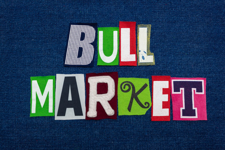 BULL MARKET text word collage, multi colored fabric on blue denim, rising price and demand concept, horizontal aspect