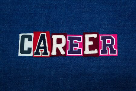 CAREER word text collage, multi colored fabric on blue denim, work diversity concept, horizontal aspect
