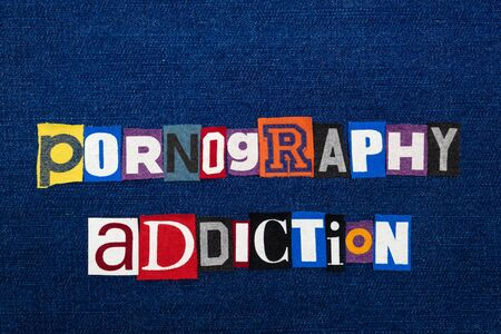 PORNOGRAPHY ADDICTION word text collage, multi colored fabric on blue denim, and addiction concept, horizontal aspect