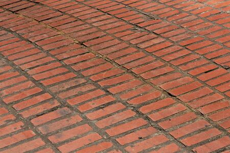 Brick background, floor with wide mortar set in sweeps, red clay brick pattern texture, horizontal aspect