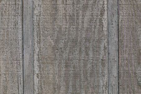 Background texture closeup of old weathered wooden panelling, paint and raw wood, horizontal aspect