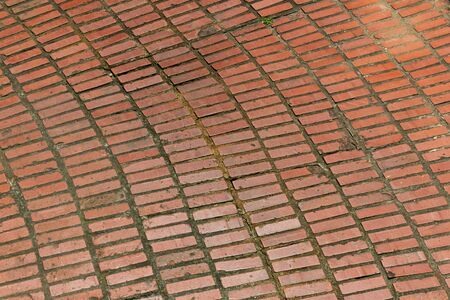 Background of large arch of rows of red brick flooring, dark mortar, copy space, horizontal aspect