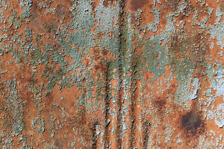 Aqua green paint, checked and crazed, flaking off a rusty metal background, horizontal aspect Stock fotó