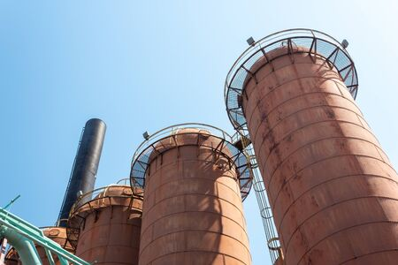 Sloss Furnaces National Historic Landmark, Birmingham Alabama USA, row of steel mill furnaces against a blue sky, copy space, horizontal aspect
