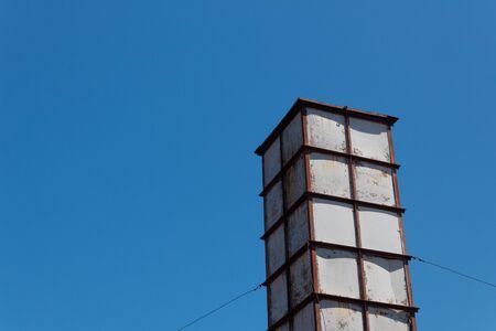 Sloss Furnaces National Historic Landmark, Birmingham Alabama USA, steel framed tower isolated against a blue sky, creative copy space, horizontal aspect