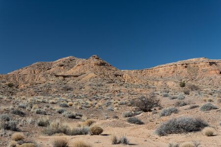 Brilliant blue sky above a mountain ridge, sage brush, New Mexico desert, horizontal aspect