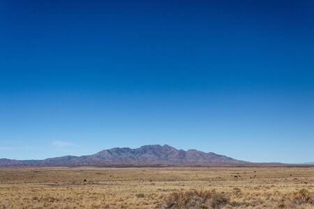 View of distant mountains across high desert plain in New Mexico USA, horizontal aspect