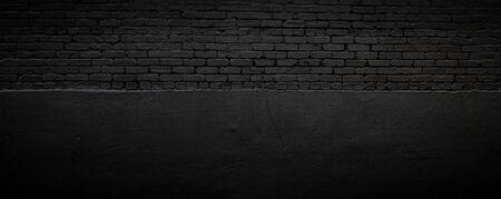Black brick and stucco background, subtle textured backdrop, creative vignette copy space, horizontal aspect