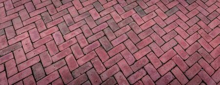 Perspective view background of bricks laid in a herringbone pattern, red brick in wide backdrop, horizontal aspect Stok Fotoğraf