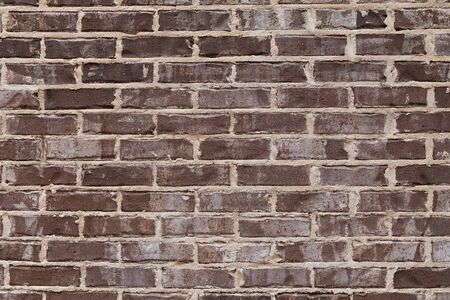 Close view of rough brown brick wall with sloppy extruded mortar finish, creative copy space, horizontal aspect Stok Fotoğraf