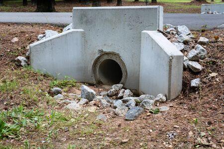 Precast concrete headwall for pipe running under a roadway, rainwater runoff culvert, horizontal aspect Stok Fotoğraf