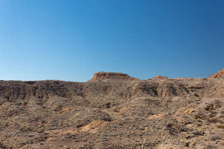 View across a wide valley in the New Mexico desert, vast open canyon with sage brush with blue sky, horizontal aspect Stock Photo