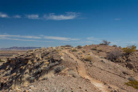 Rock lined beaten path along a ridge, Sevilleta National Wildlife Refuge, New Mexico USA, horizontal aspect