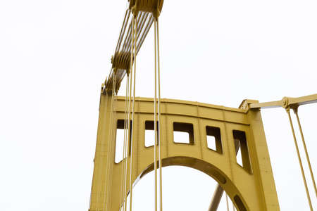 Support structure of a self-anchored suspension bridge, grey sky copy space, horizontal aspect