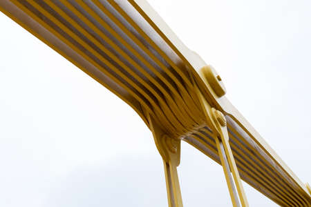 Detail of a joint in a self anchored suspension bridge painted bright yellow, horizontal aspect