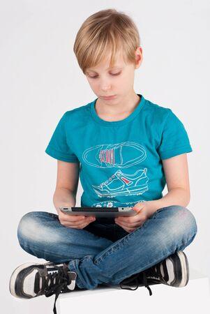 A boy uses a digital tablet Stock Photo - 17288039