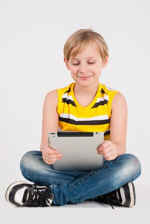 A boy uses a digital tablet Stock Photo - 17288038