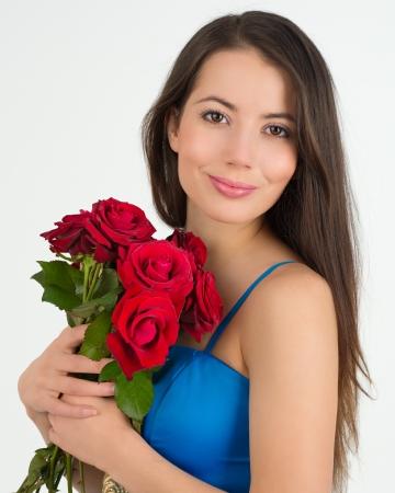mujer con rosas: Mujer con flores Foto de archivo