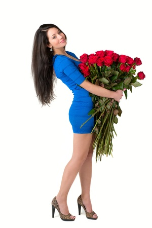 Brunette woman holding a large bouquet of red roses