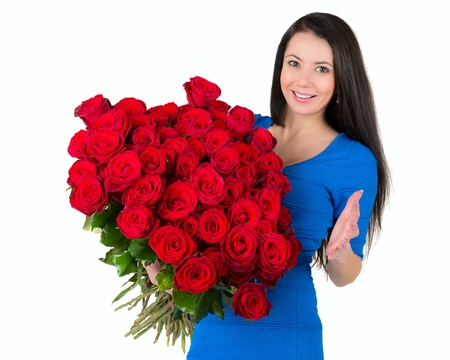 flowergirl: Pretty brunette holding a large bouquet of red roses