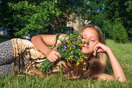 fragrant: Girl with wild flowers Stock Photo
