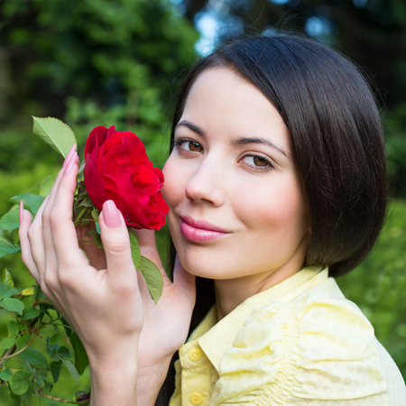 Portrait of a Woman with a red rose Stock Photo - 23572220