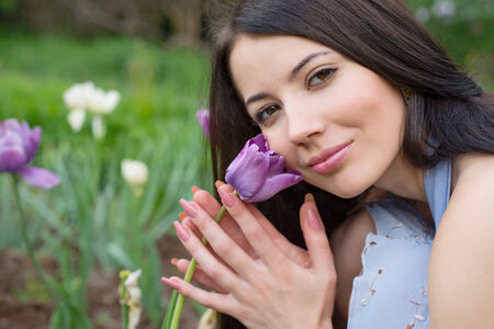 Portrait of a young woman with tulips photo