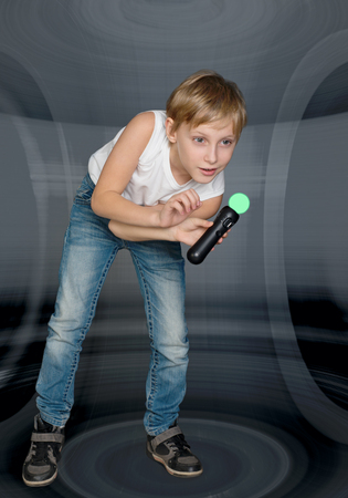 Boy playing a video game controller photo