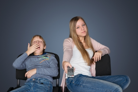 Boy and girl watching TV photo