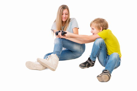 Boy and girl fighting over a joystick photo