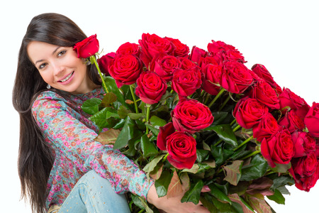 Young woman c bouquet of red roses
