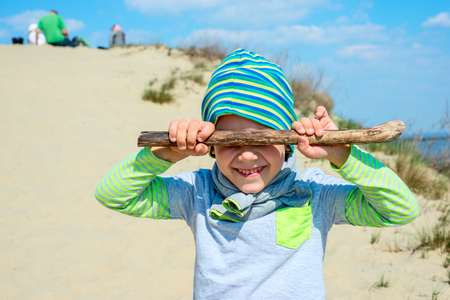 close your eyes: Boy closed his eyes with a stick Stock Photo