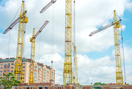 Construction site with cranes on the sky photo