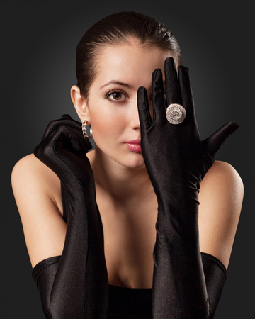 black gloves: Glamorous Woman in Black Gloves with a Circular Ring Stock Photo