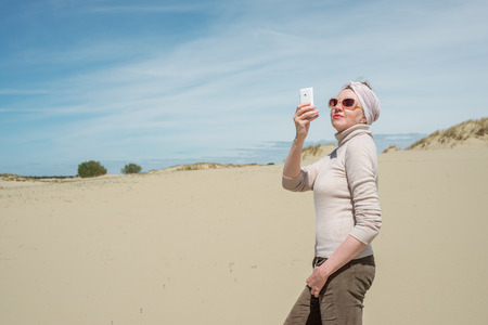 extravagant: Extravagant woman doing selfie on vacation