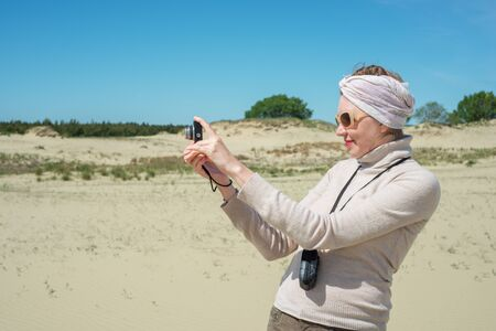 Woman remove a camera on vacation photo