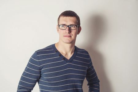 v neck: Portrait of a young man with glasses
